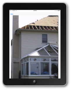 Photo of a damaged building from the Crisis Track mobile app